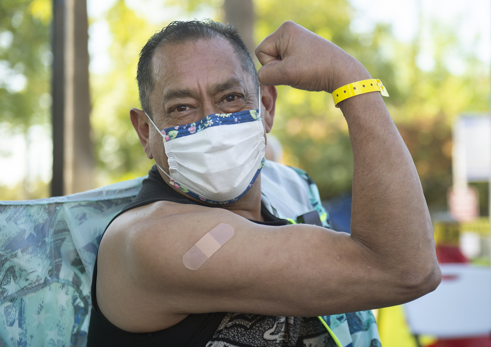 An elderly resident shows off the arm where he was vaccinated.